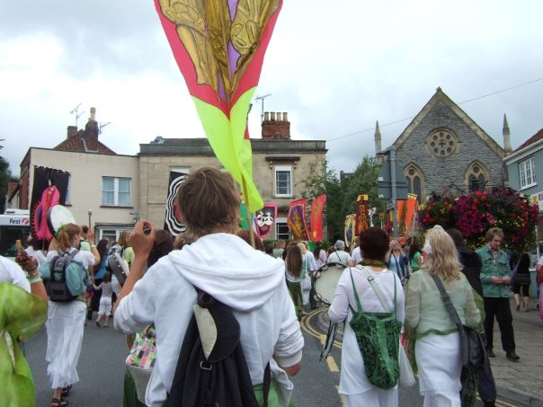 A procession of Pagan pilgrims through Glastonbury.